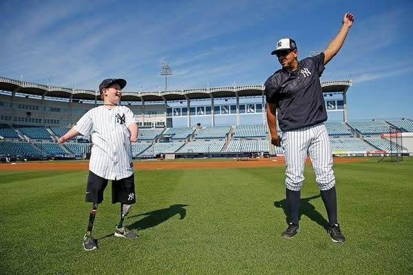 10-year-old Landis Sims is seen working out with Yankees star Alex Rodriguez during spring training in Florida on Monday.