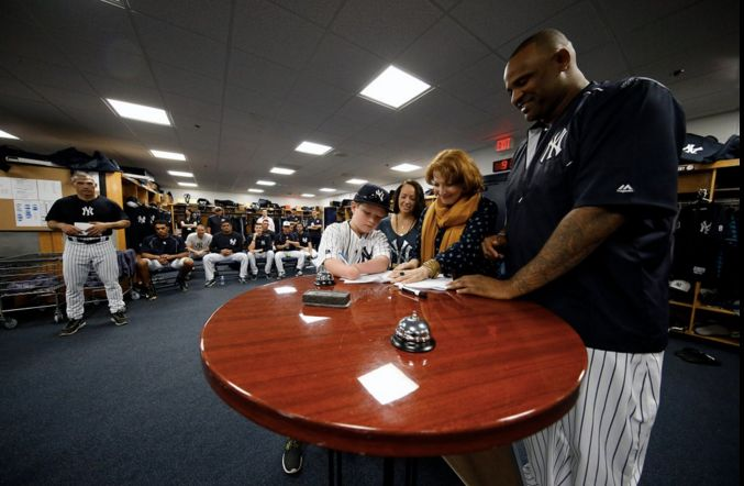 The fourth grader signed a one-day contract with the Yankees, an event that was overseen by his family andpitcher CC Sa
