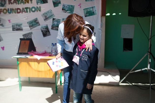 Nora Jumblatt embraces a student at the Malala School on March 7,