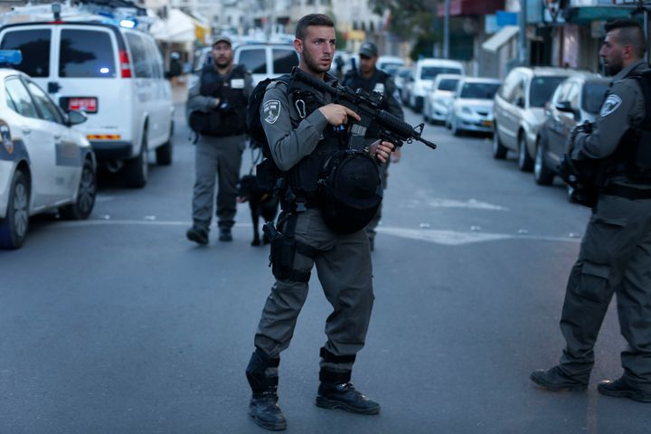 Israeli security forces gather in East Jerusalem's following a shooting attack on March 8, 2016. Therefour attacks by P