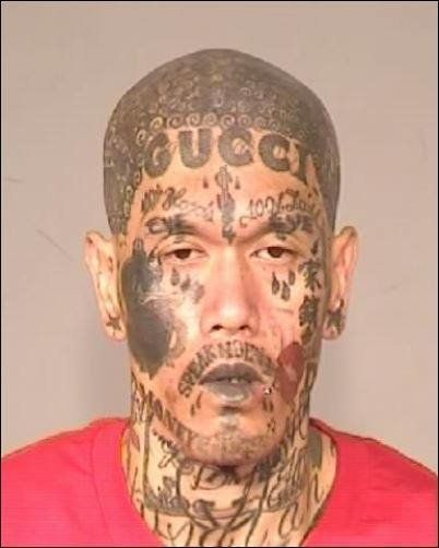 Heavily tattooed gang member forced to face the music for Gang face tattoos