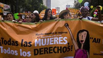 A group of women hold a banner during the Women's World March at the Zocalo square in Mexico City on August 5, 2008, in the sidelines of the XVII International AIDS/HIV Conference. AFP PHOTO/Alfredo Estrella (Photo credit should read ALFREDO ESTRELLA/AFP/Getty Images)