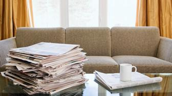 Stack of Newspapers on Coffee Table