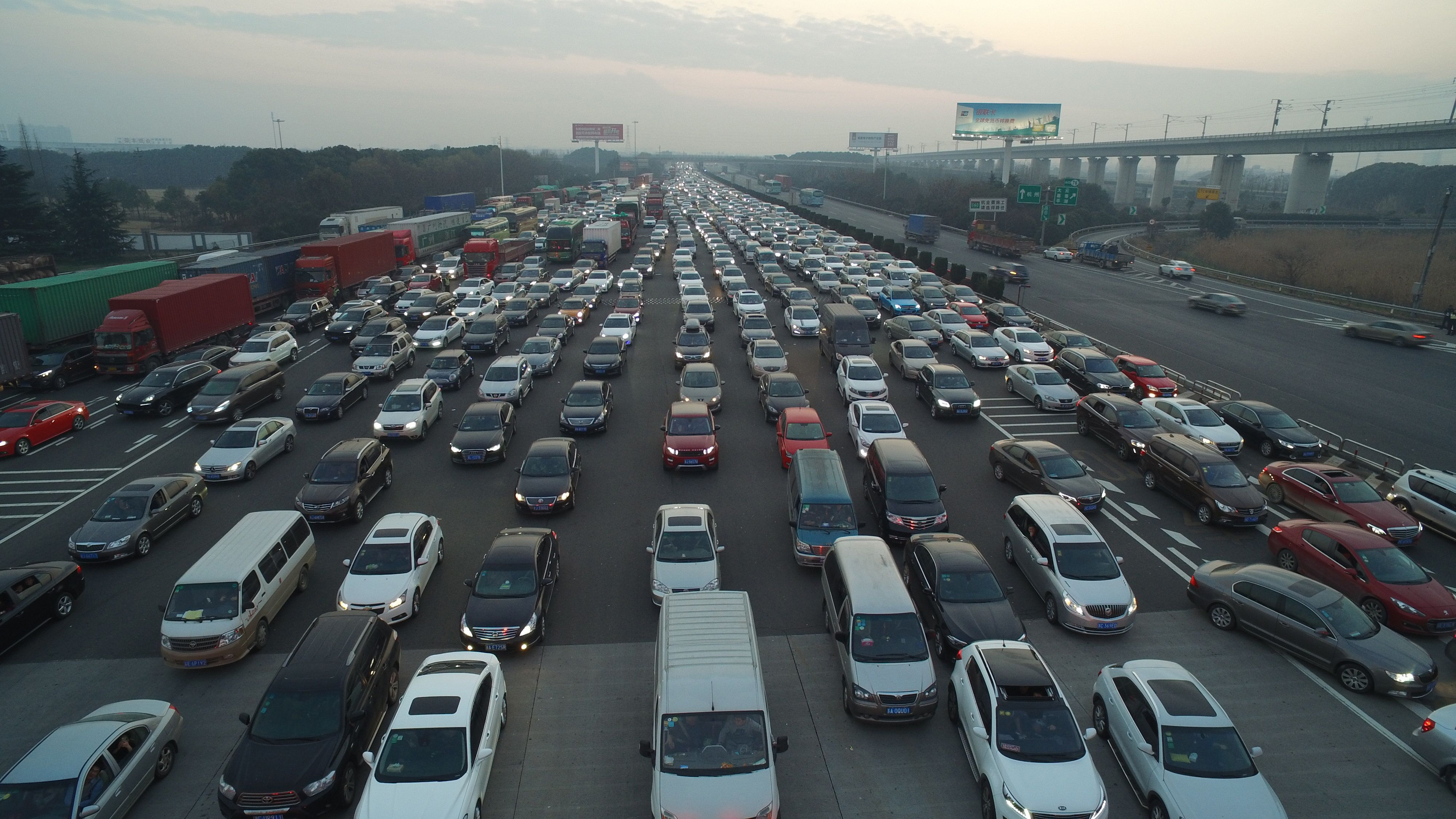 JIAXING, CHINA - JANUARY 03:  (CHINA OUT) Picture shows the traffic jam at a toll station on G60 Shanghai-Kunming Expressway at the end of New Year's Day holiday on January 3, 2016 in Jiaxing, Zhejiang Province of China. People driving back after the 3-day holiday of the New Year's Day caused a 3-kilometer traffic jam at a toll station on G60 Shanghai-Kunming Expressway in Jiaxing.  (Photo by ChinaFotoPress/ChinaFotoPress via Getty Images)