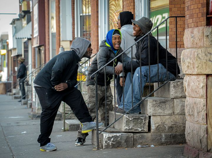 Young menshare a laugh on Dec. 3, 2015, near the unofficial ground zero of theBaltimore riots.