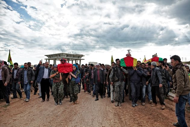 On April 14, 2015, a group of YPJ and YPG (People's Protection Unit) fighters carry the coffins...