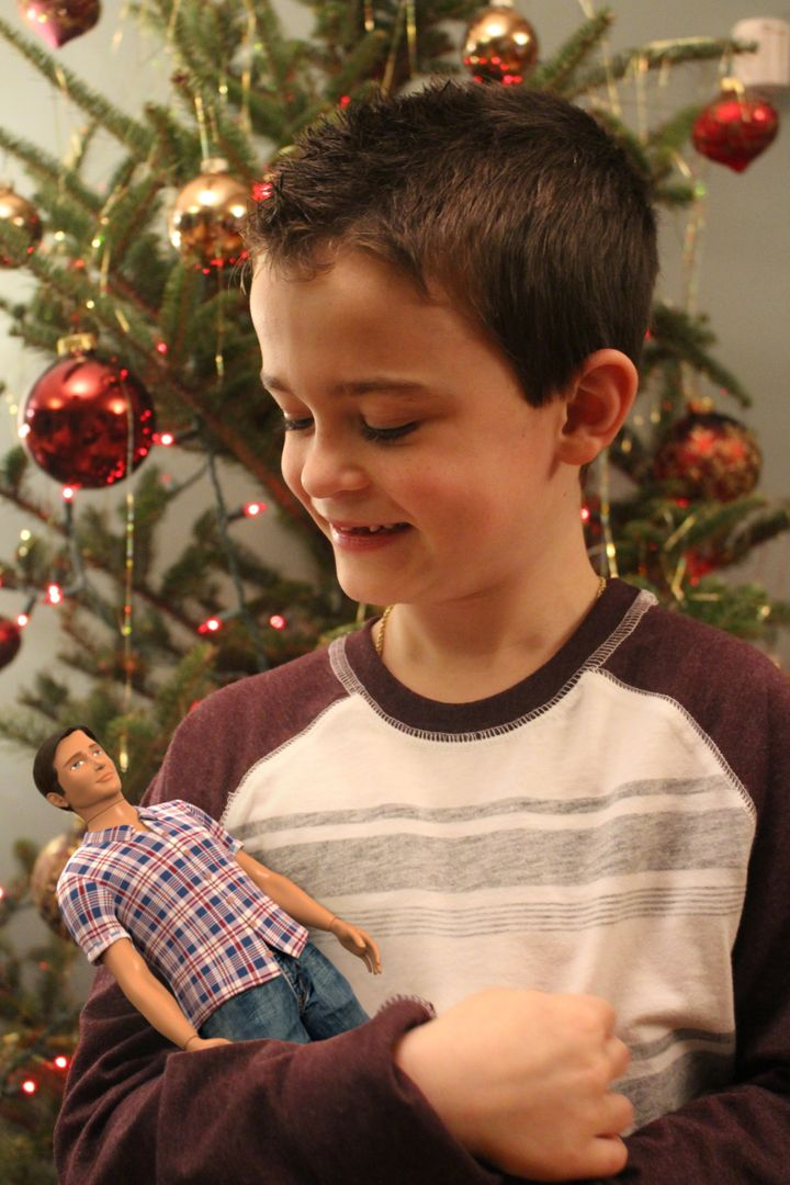 Boys also face a harmfulpressure to look and act a certain way, says the doll's creator.