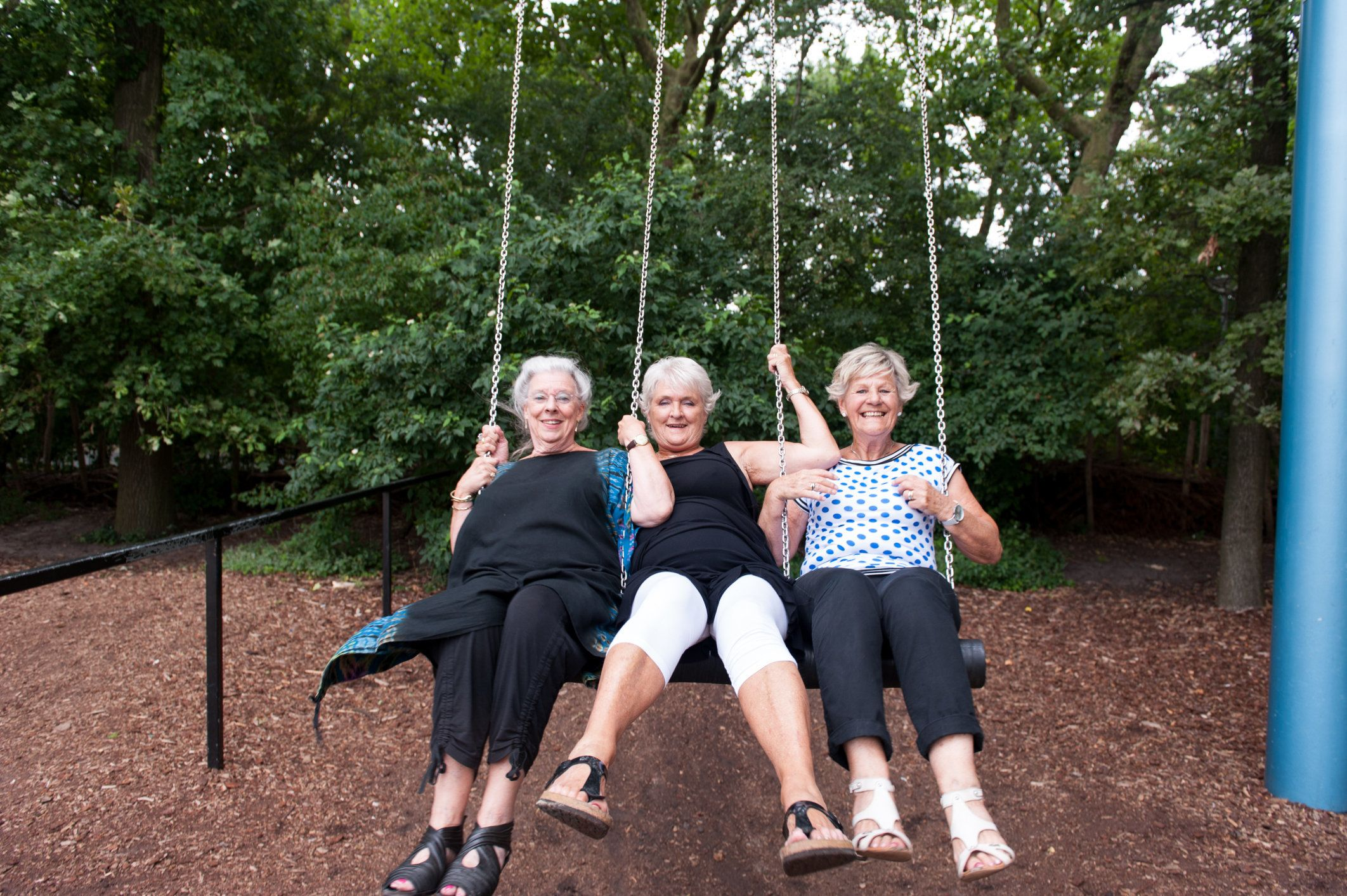 Large swing for three people, with three elderly girlfriends.