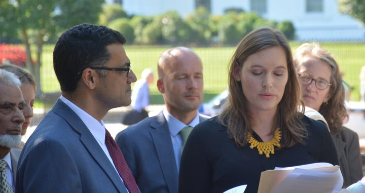 Catherine Orsborn (right) speaks at a press conference on the Syria conflict and the refugee crisis in front of the White House in Sept. 2015.