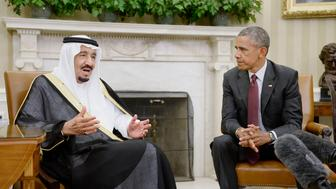 U.S. President Barack Obama, right, listens as King Salman bin Abdulaziz Al Saud of Saudi Arabia speaks during a meeting in the Oval Office at the White House in Washington, D.C., U.S., on Friday, Sept. 4, 2015. 'This is obviously a challenging time in world affairs, particularly in the Middle East,' Obama told reporters, mentioning energy near the end of a list of topics that he and Salman would address. Photographer: Olivier Douliery/Bloomberg via Getty Images