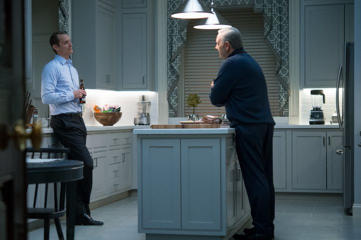 Frank Underwood and Will Conway quarrel in the kitchen.