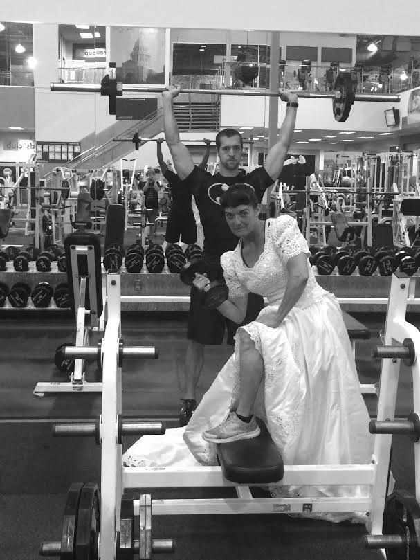 Herrera at the gym in her wedding gown.