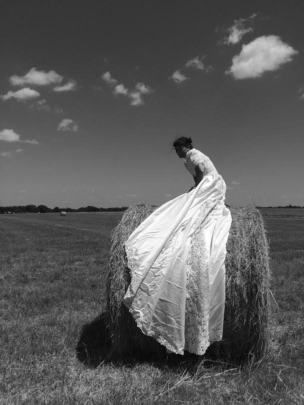 Herrera on a bale of hay.