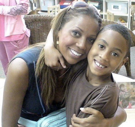 """Holly with RJ several years ago. The Peetes refer to the day of RJ's diagnosis as the """"never day,"""" after hearing from the doctor all of the things their son would never do."""