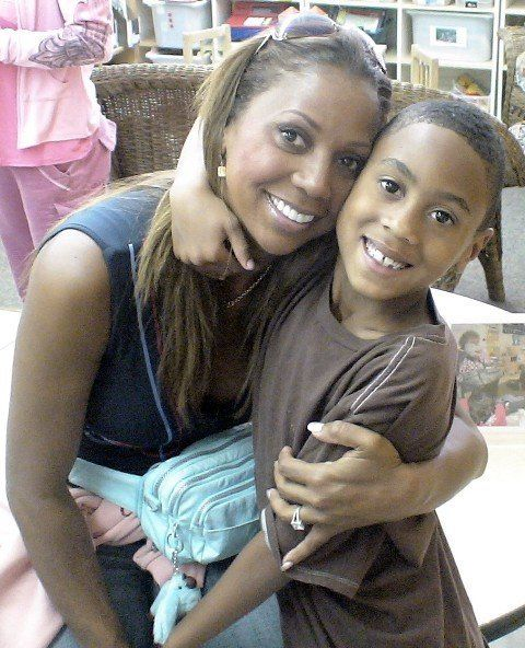 "Holly with RJ several years ago. The Peetes refer to the day of RJ's diagnosis as the ""never day,"" after hearing from the doc"