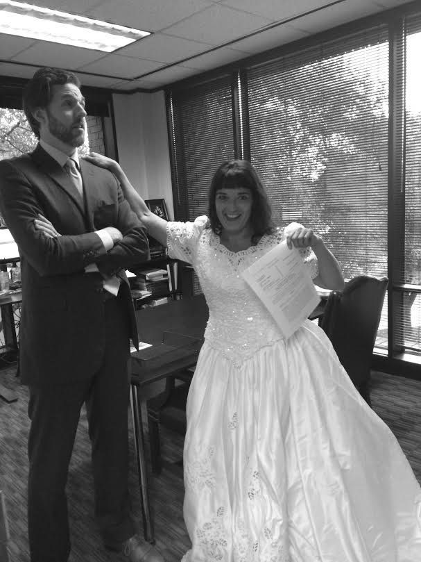 Attorney at law Sam Colletti poses with Herrera and the famous dress.