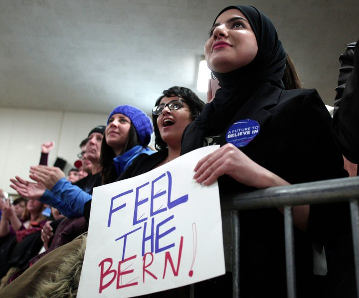 People listen to Democratic presidential candidate Sen. Bernie Sanders (I-Vt.) speak at a campaign rally at United Auto Worke