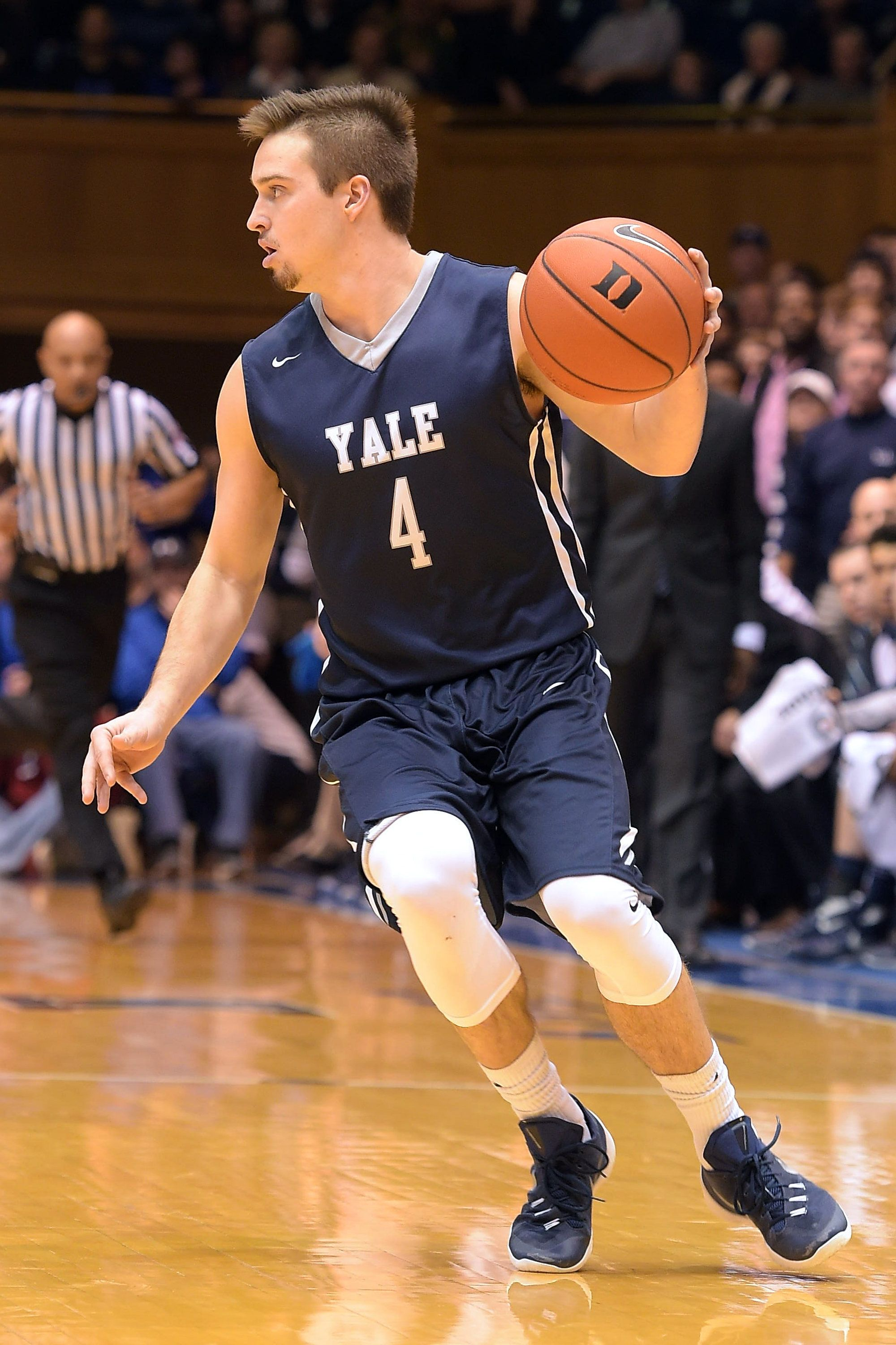 DURHAM, NC - NOVEMBER 25: Jack Montague #4 of the Yale Bulldogs moves the ball against the Duke Blue Devils at Cameron Indoor Stadium on November 25, 2015 in Durham, North Carolina. Duke defeated Yale 80-61. (Photo by Lance King/Getty Images)