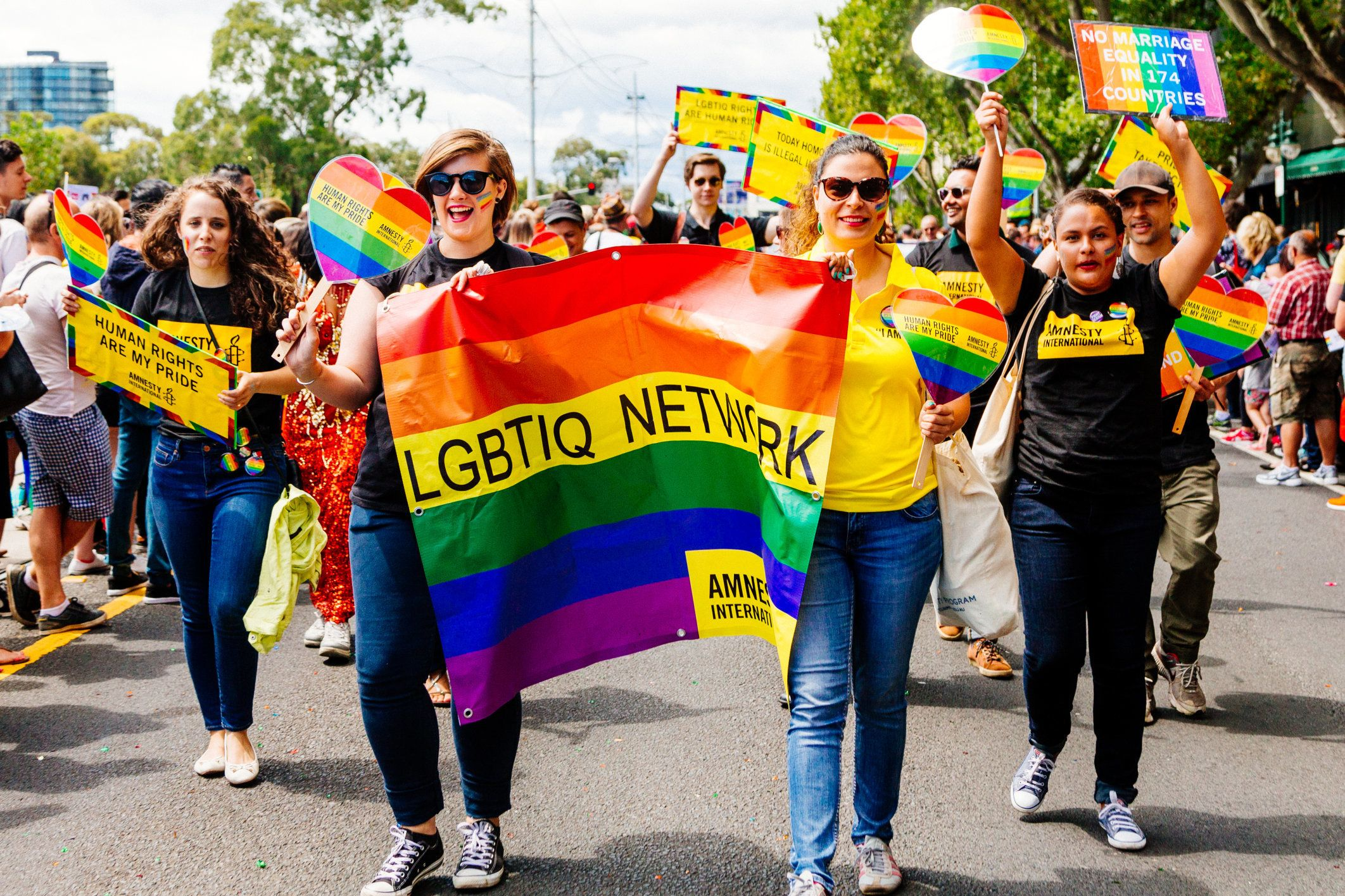 Members of the Amnesty International LGBTIQ network march during the MidSumma festival Pride march in Australia, calling for