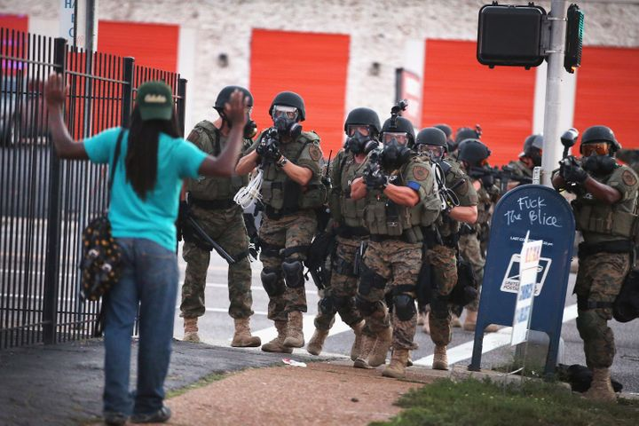 Police in Ferguson, Missouri,responded with tear gas and rubber bullets as residents protested the fatalpolice sh