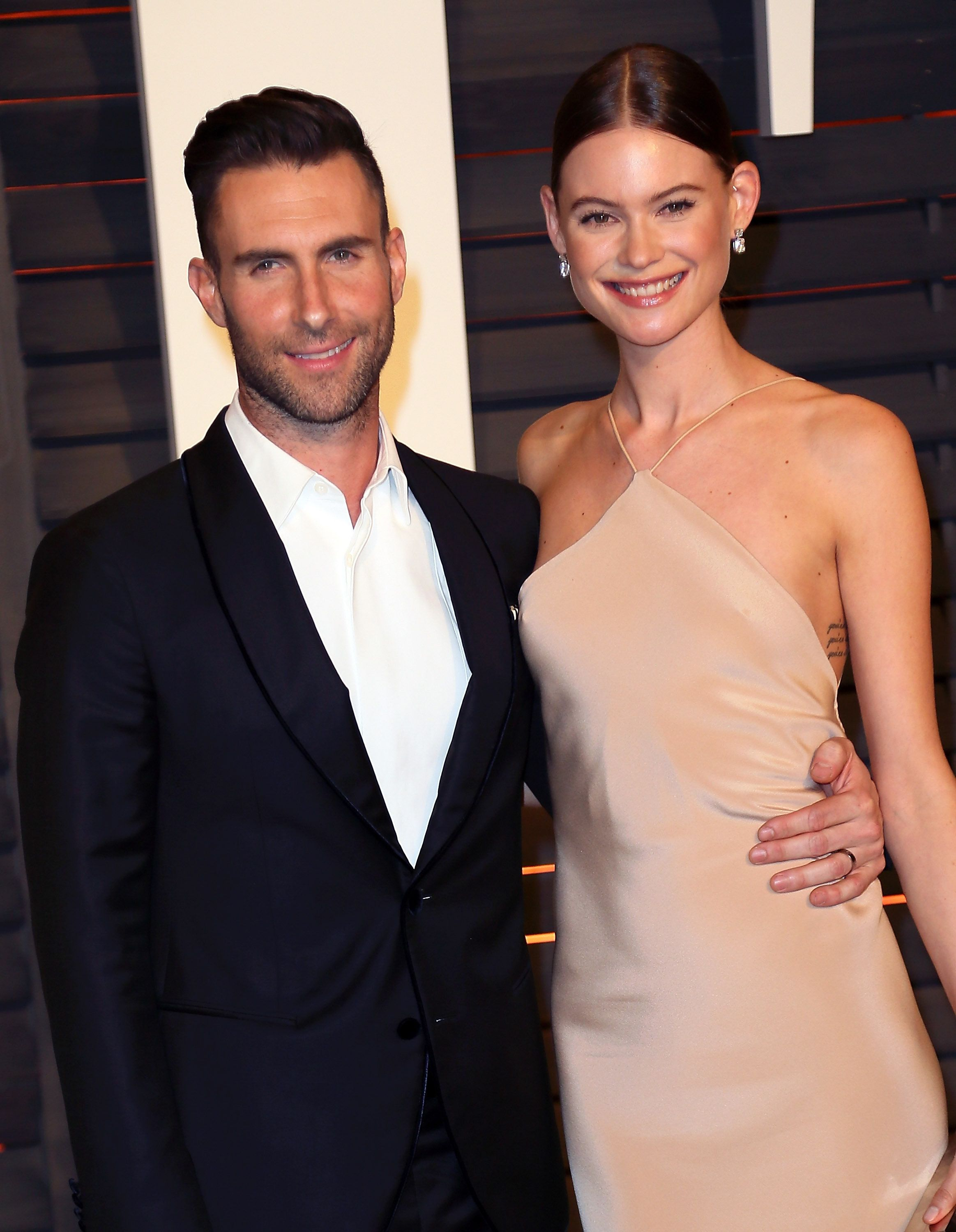 BEVERLY HILLS, CA - FEBRUARY 22:  Recording artist Adam Levine (L) and wife model Behati Prinsloo attend the 2015 Vanity Fair Oscar Party hosted by Graydon Carter at the Wallis Annenberg Center for the Performing Arts on February 22, 2015 in Beverly Hills, California.  (Photo by David Livingston/Getty Images)