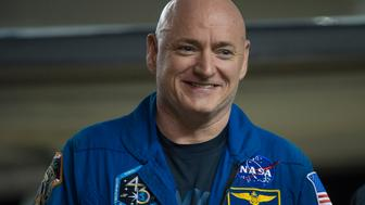 HOUSTON, TEXAS - MARCH 03:  In this handout provided by NASA, Scott Kelly of NASA is seen as he arrives after landing at Ellington Field after his return to Earth on March 3, 2016 in Houston, Texas.   Kelly and Flight Engineers Mikhail Kornienko and Sergey Volkov of Roscosmos landed in their Soyuz TMA-18M capsule in Kazakhstan on March 1 (Eastern time). Kelly and Kornienko completed an International Space Station record year-long mission as members of Expeditions 43, 44, 45, and 46 to collect valuable data on the effect of long duration weightlessness on the human body that will be used to formulate a human mission to Mars.  Volkov returned after spending six months on the station.  (Photo by Joel Kowsky/NASA via Getty Images)