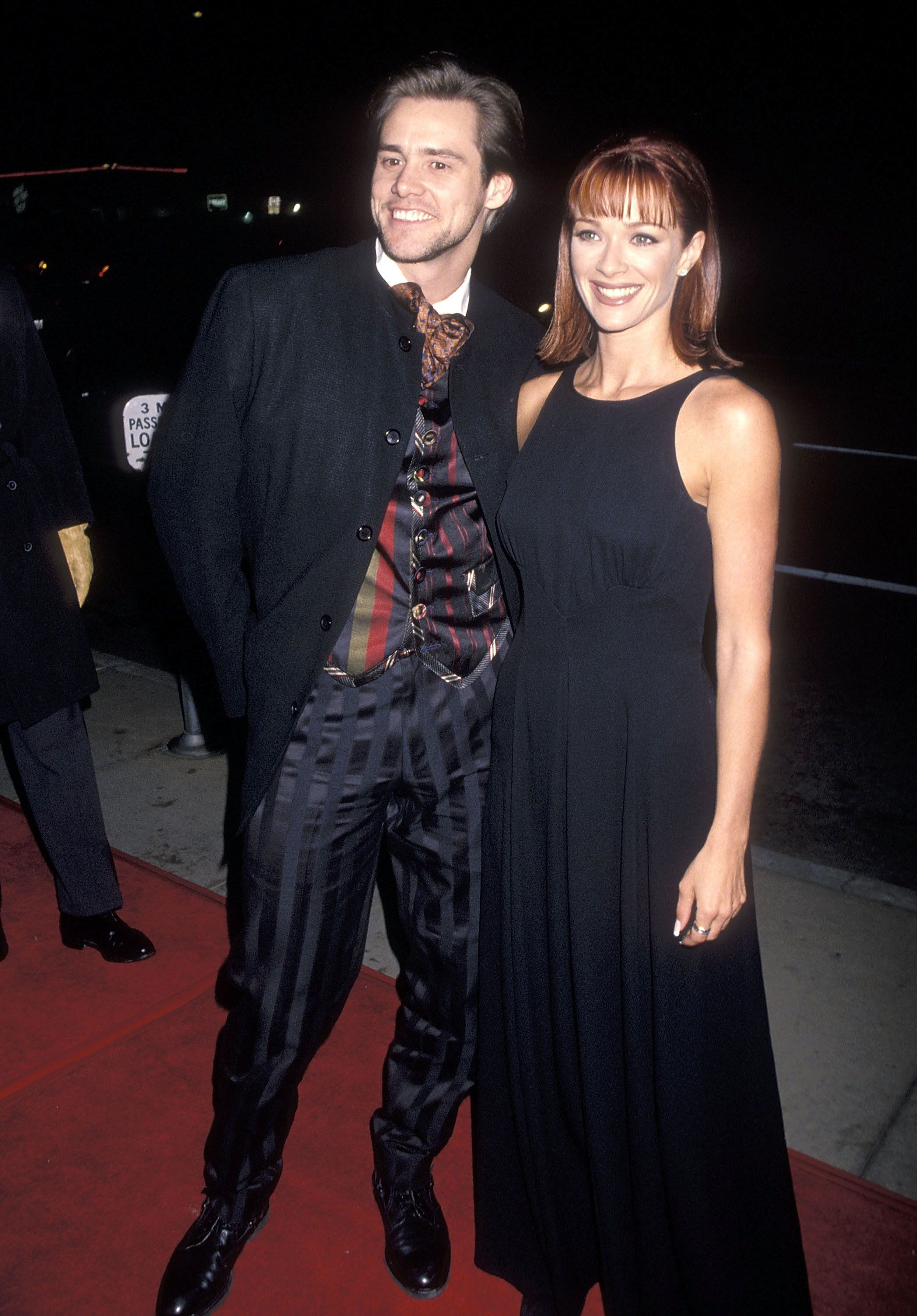 "HOLLYWOOD - DECEMBER 6:   Actor Jim Carrey and actress Lauren Holly attend the ""Dumb and Dumber"" Hollywood Premiere on December 6, 1994 at the Pacific's Cinerama Dome in Hollywood, California. (Photo by Ron Galella, Ltd./WireImage)"