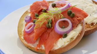 Smoked salmon lox with cream cheese capers and red onion on toasted Asiago cheese bagel