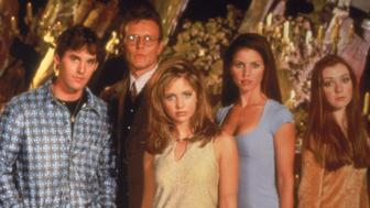 Promotional portrait of the cast for the television series, 'Buffy The Vampire Slayer,' c. 1997. L-R: Nicholas Brendon, Anthony Head, Sarah Michelle Gellar, Charisma Carpenter and Alyson Hannigan. (Photo by Fotos International/Courtesy of Getty Images)