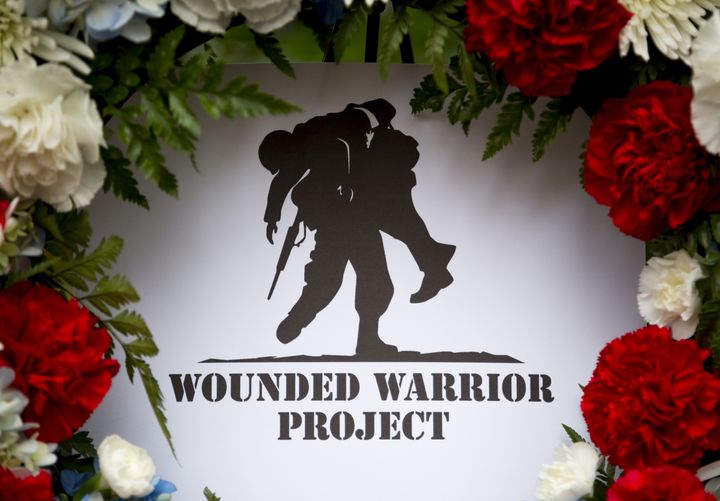 A wreath from the Wounded Warrior Project is seen at the Eternal Light Monument on Veterans Day. The organization fired its C