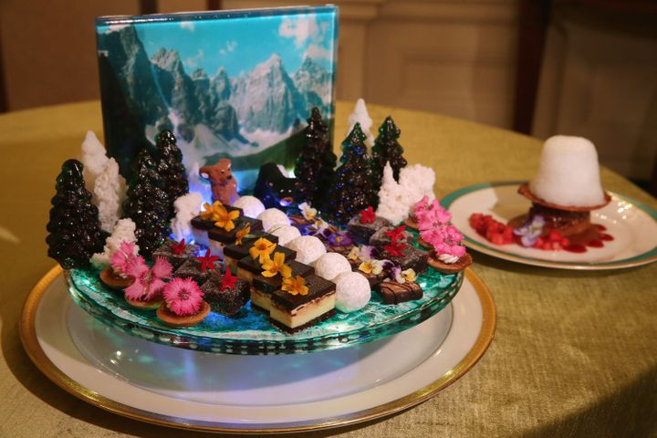 A display of bite-size sweets uses a photograph of the Rocky Mountains as a backdrop for the state dinner honoring Canadian P