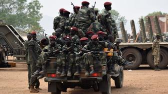 JUBA, SOUTH SUDAN - FEBRUARY 19: Soldiers from the South Sudanese army (SPLA) are seen as they retreat after the peace agreement signed between President of South Sudan Salva Kiir Mayardit and South Sudan's rebel leader Riek Machar in Juba, South Sudan on February 19, 2016.   (Photo by Samir Bol/Anadolu Agency/Getty Images)