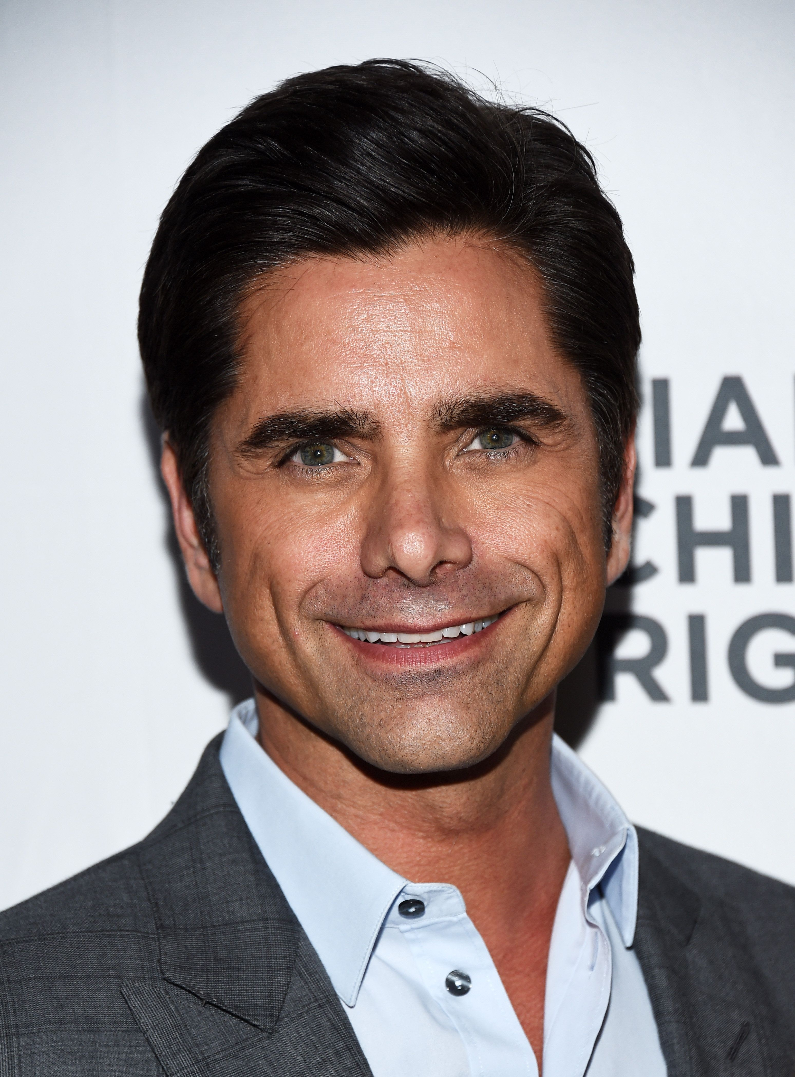 BEVERLY HILLS, CA - MARCH 10:  Actor John Stamos arrives at the Alliance For Children's Rights' 24th Annual Dinner at The Beverly Hilton Hotel on March 10, 2016 in Beverly Hills, California.  (Photo by Amanda Edwards/WireImage)
