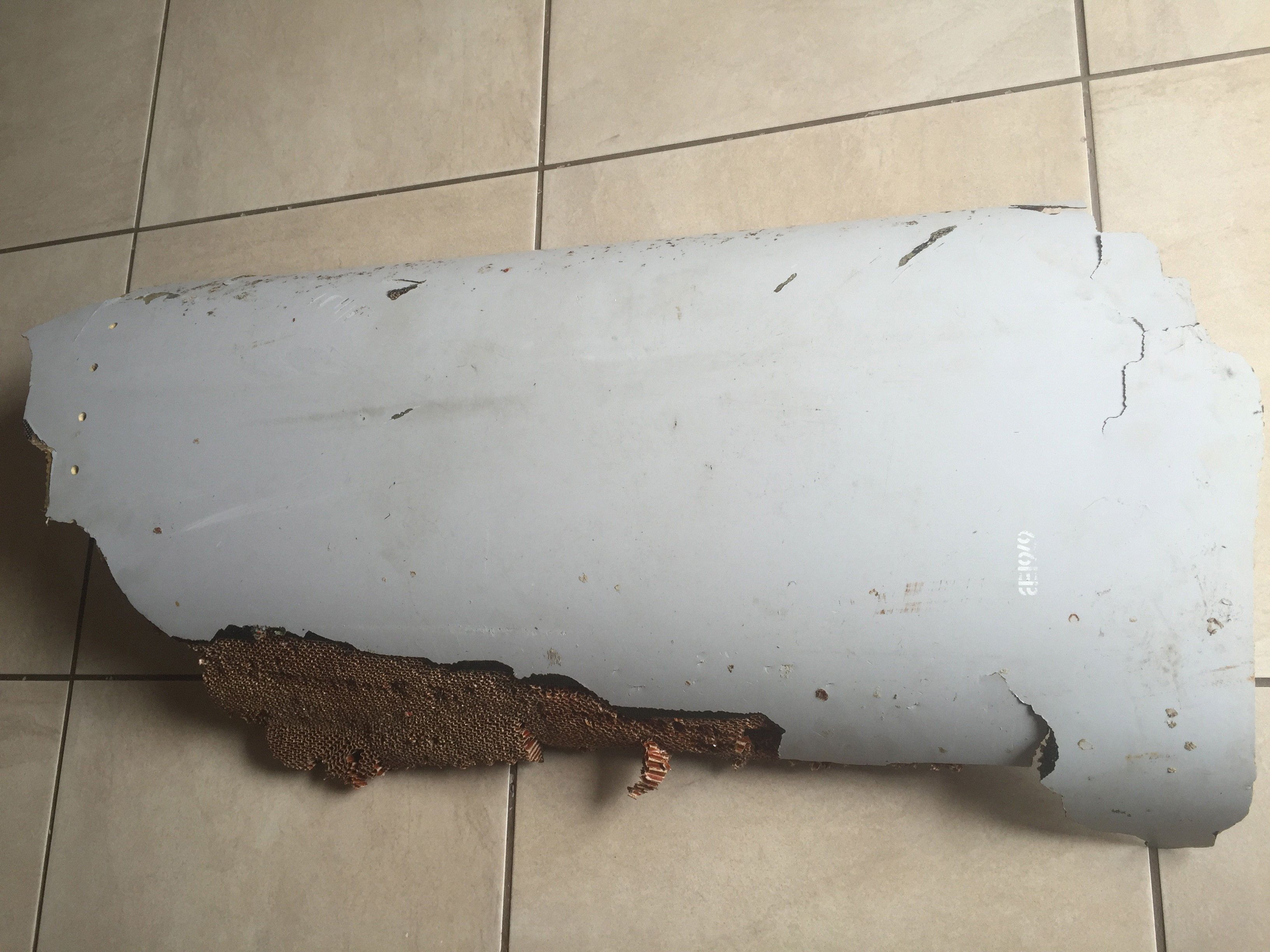 A piece of debris found by a South African family off the Mozambique coast in December 2015, which authorities will examine to see if it is from missing Malaysia Airlines flight MH370, is pictured in this handout photo released to Reuters March 11, 2016. REUTERS/Candace Lotter/Handout via Reuters      ATTENTION EDITORS - THIS PICTURE WAS PROVIDED BY A THIRD PARTY. REUTERS IS UNABLE TO INDEPENDENTLY VERIFY THE AUTHENTICITY, CONTENT, LOCATION OR DATE OF THIS IMAGE. FOR EDITORIAL USE ONLY. NOT FOR SALE FOR MARKETING OR ADVERTISING CAMPAIGNS. NO RESALES. NO ARCHIVE. THIS PICTURE IS DISTRIBUTED EXACTLY AS RECEIVED BY REUTERS, AS A SERVICE TO CLIENTS. MUST ON SCREEN COURTESY CANDACE LOTTER. MANDATORY CREDIT      TPX IMAGES OF THE DAY - RTSACE8
