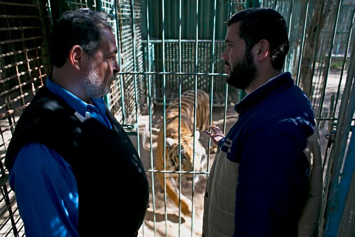 Zoo owner MohammadOweida, right, is trying to sell his tiger to reclaim some of hislost profits.
