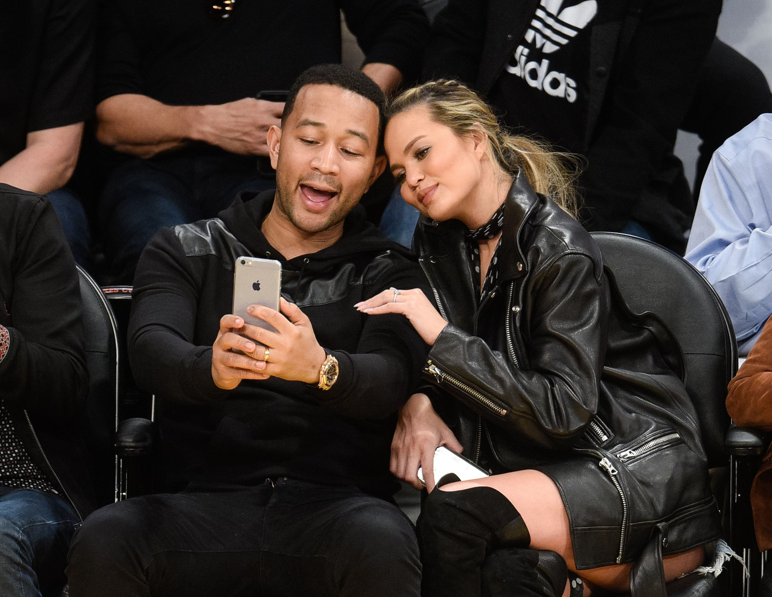 LOS ANGELES, CA - MARCH 10:  John Legend and Chrissy Teigen attend a basketball game between the Cleveland Cavaliers and the Los Angeles Lakers at Staples Center on March 10, 2016 in Los Angeles, California.  (Photo by Noel Vasquez/GC Images)