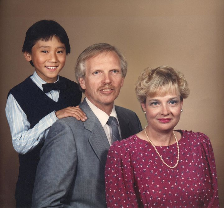 Anders as a child with his adoptive parents.