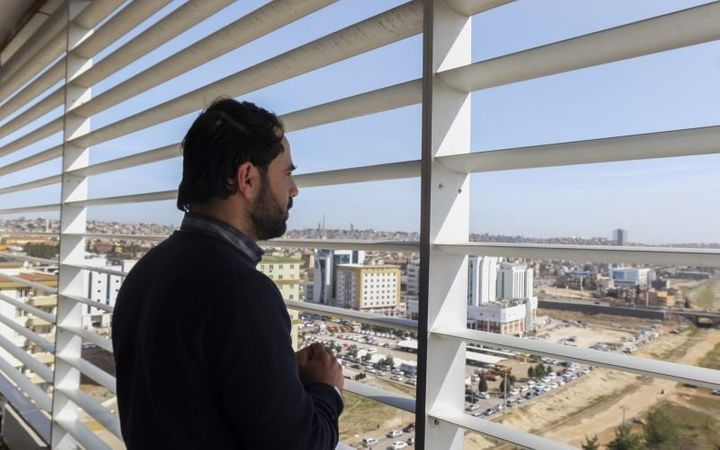Dr. Hatem, the Director of Aleppo's Children Hospital, overlooks Gaziantep during a brief family visit to Turkey as Aleppo wa