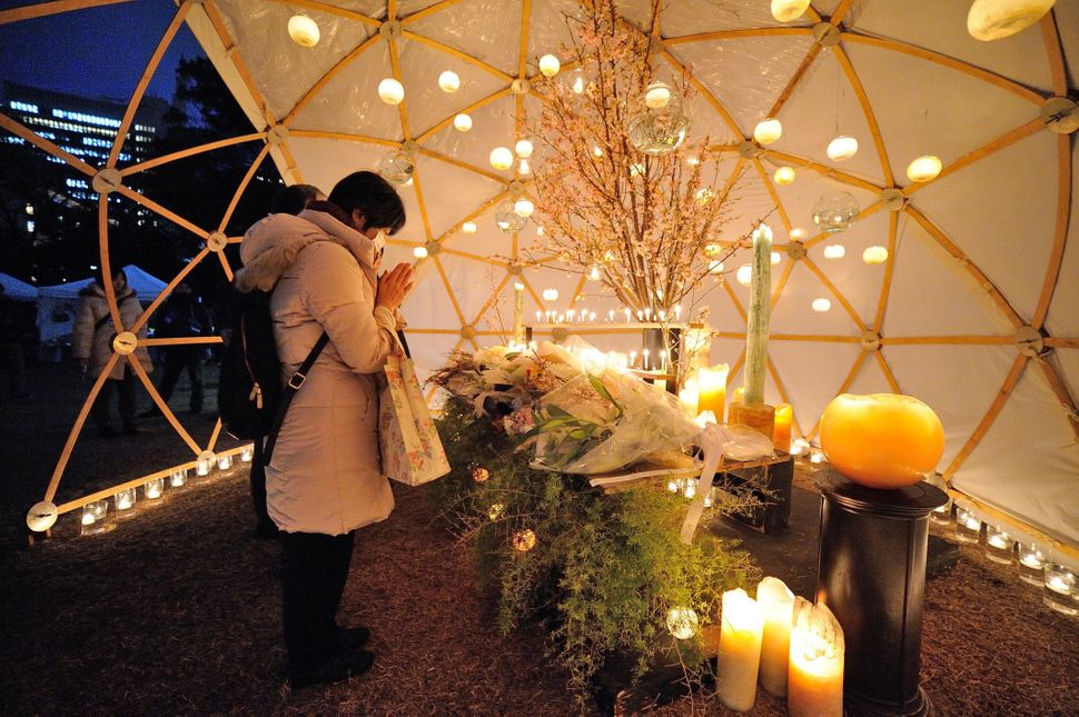 A woman prays in a dome in Tokyo.