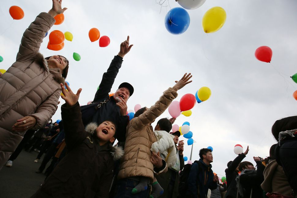 People release balloons in Sendai.