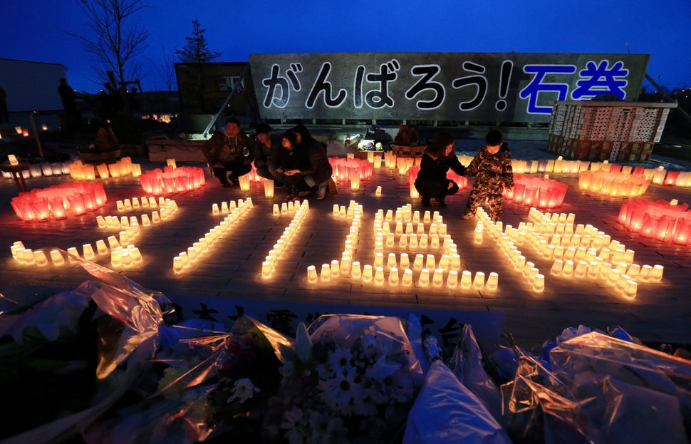 "Candles spell out ""3.11 memorial"" in Japanese in Ishinomaki, a city in the Tohoku region."