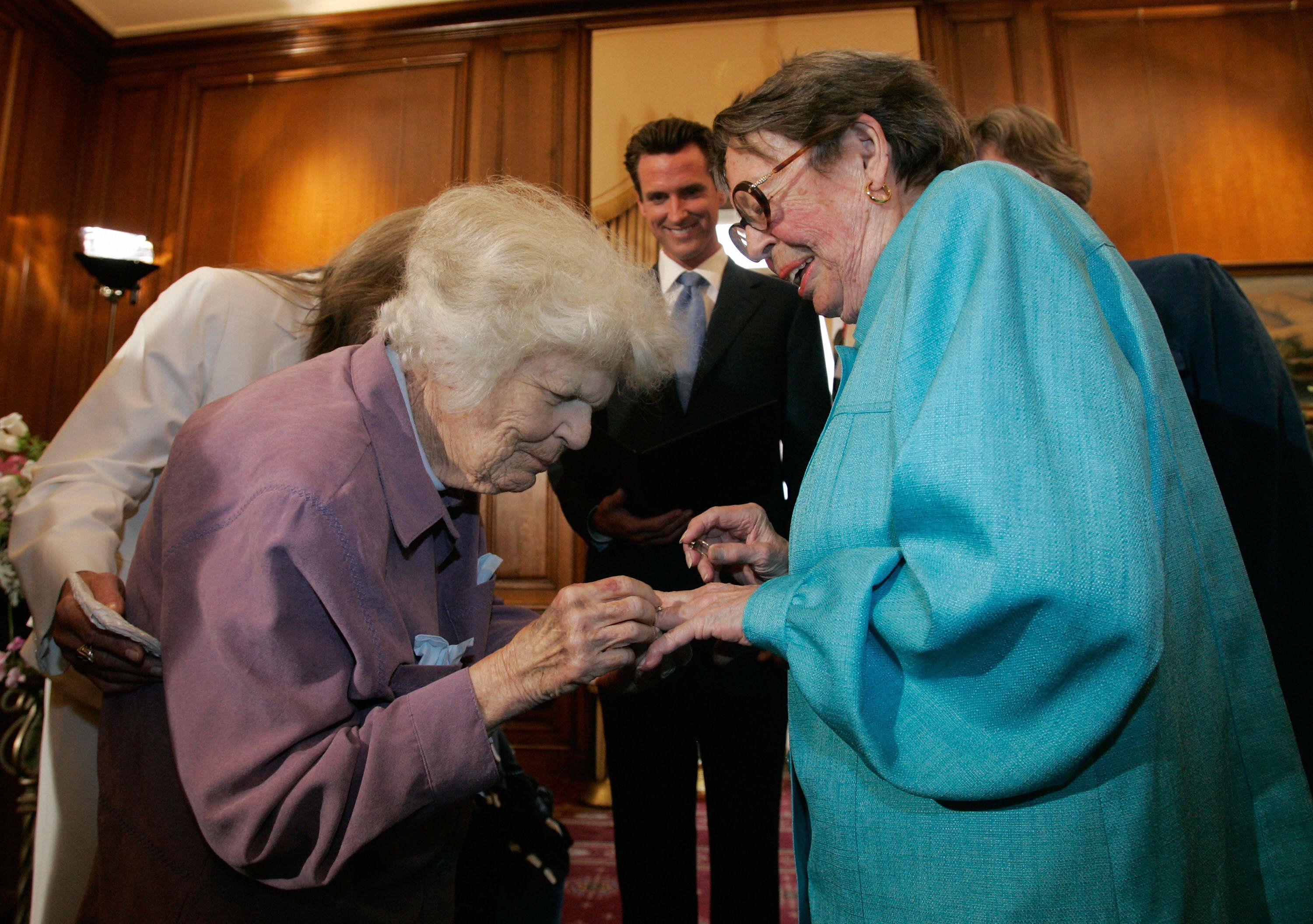 Same-sex couple Del Martin (L) and Phyllis Lyon (R) exchange rings as they are married by San Francisco mayor Gavin Newsom in a private ceremony at San Francisco City Hall June 16, 2008 in San Francisco, California. Martin and Lyon were the first couples to be married in San Francisco as same-sex marriages become legal  in California.     AFP PHOTO / POOL / Marcio Jose Sanchez (Photo credit should read Marcio Jose Sanchez/AFP/Getty Images)