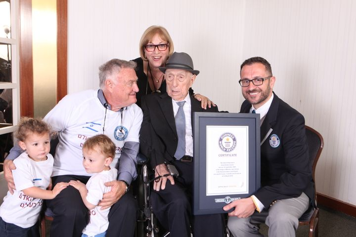 Marco Frigatti, Head of Records for Guinness World Records, presents Israel Kristal his certificate of achievement for Oldest