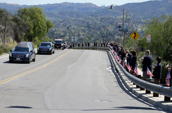 Library volunteers line the road as the hearse carrying the body of Nancy Reagan arrives at the Ronald Reagan Presidential Li