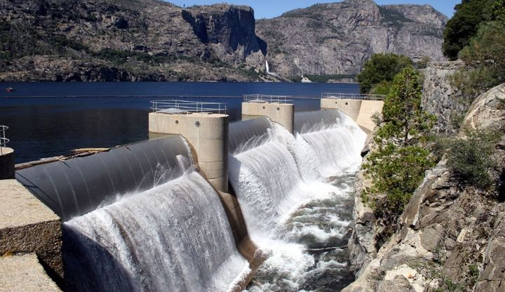 Water overflows from the dam at Hetch Hetchy reservoir, one of the main reservoirs in the San Francisco Public Utilities Comm