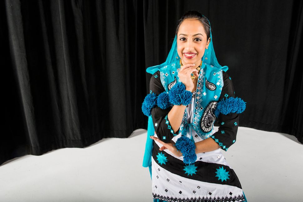 CU Bhangra dancer and student Amrita Doshi poses in her traditional bhangra costume.
