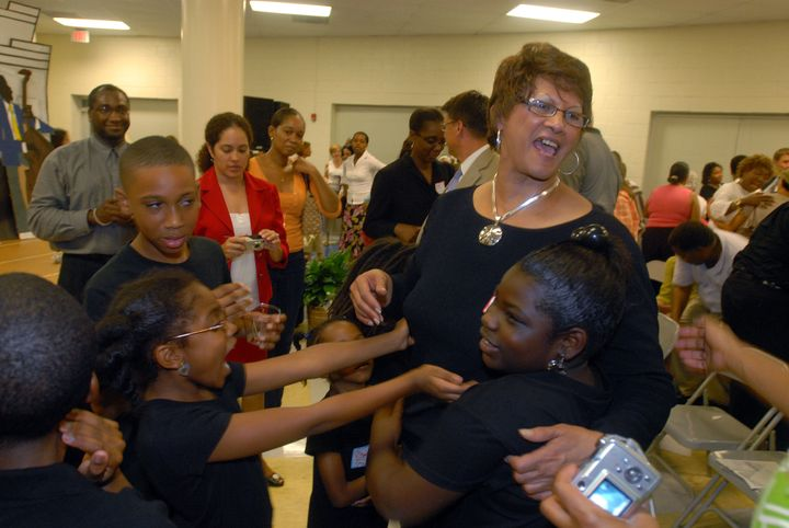Dorothy Counts-Scoggins several years ago with Charlotte students.