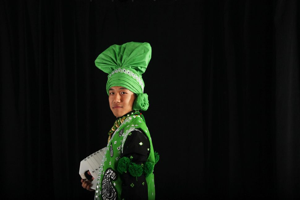 "CU Bhangra dancer Benjamin Yi wears a traditional turban, called a ""pagh<i>,"" </i>as part of his bhangra costume."