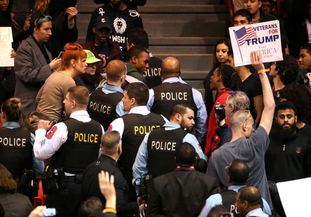 A demonstrator is removed by Chicago police during a rally for Republican presidential candidate Donald...