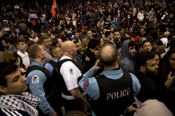 Anti-Trump protesters confront his supporters during a Trump rally at the UIC Pavilion in Chicago on March 11, 2016.